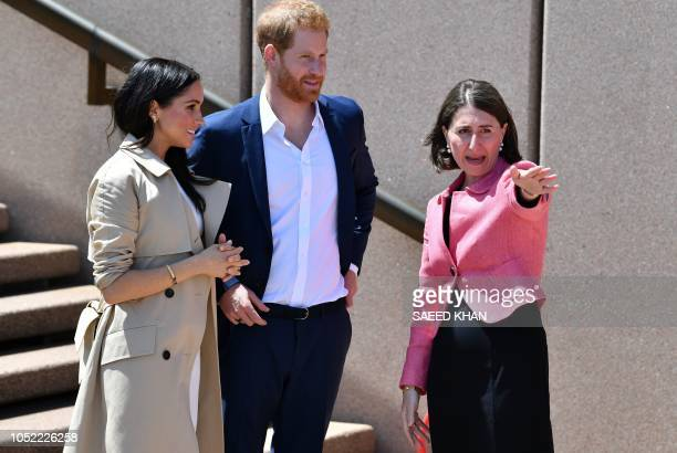 Australia's New South Wale premier Gladys Berejiklian receives Britain's Prince Harry and his wife Meghan outside the Sydneys iconic Opera House on...