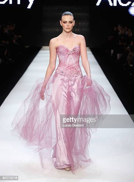 Australia's Next Top Model Winner Demelza Reveley showcases designs by Alex Perry on the catwalk at the Fashion Targets Breast Cancer with Alex Perry...