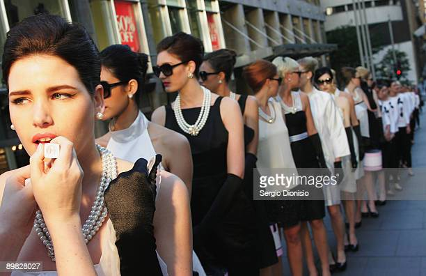 Australia's Next Top Model winner Tahnee Atkinson madeup to look like screen star Audrey Hepburn prepare backstage to celebrate Hepburn's 80th...