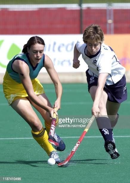 Australia's Ngaire Smith challenges Alison Grant of Scotland at Belle Vue Stadium Manchester 26 July 2002 in the first game of the 17th Commonwealth...