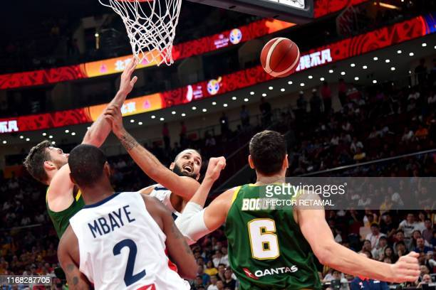 TOPSHOT Australia's Nick Kay and France's Evan Fournier fight for the ballas Australia's Andrew Bogut watches during the Basketball World Cup third...