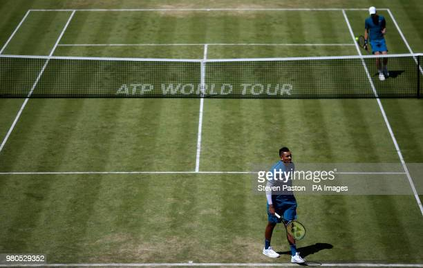 Australia's Nick Kyrgios and Great Britain's Kyle Edmund during day four of the FeverTree Championship at the Queen's Club London