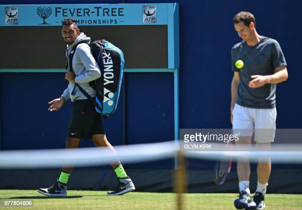TOPSHOT Australia's Nick Kyrgios has a word with Britain's Andy Murray as he practices ahead of their first round match at the ATP Queen's Club...