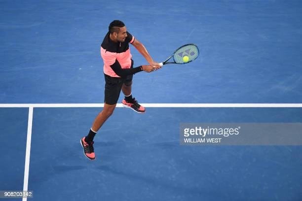 TOPSHOT Australia's Nick Kyrgios hits a return against Bulgaria's Grigor Dimitrov during their men's singles fourth round match on day seven of the...