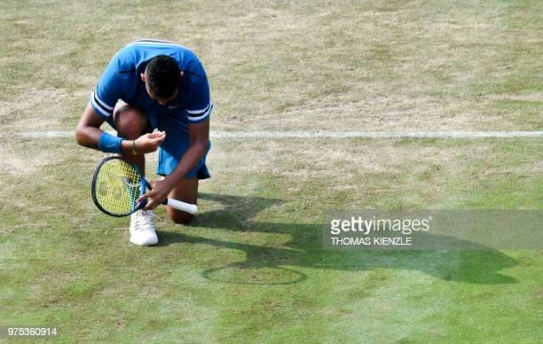 Australia's Nick Kyrgios knees down after winning against Spain's Feliciano Lopez in their quarterfinal match at the ATP Mercedes Cup tennis...