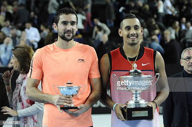 Australia's Nick Kyrgios poses with his trophy next to his opponent Croatia's Marin Cilic after winning the ATP Marseille Open 13 Provence final...
