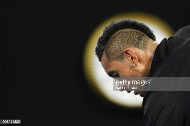 TOPSHOT Australia's Nick Kyrgios prepares to serve against Bulgaria's Grigor Dimitrov during their men's singles fourth round match on day seven of...