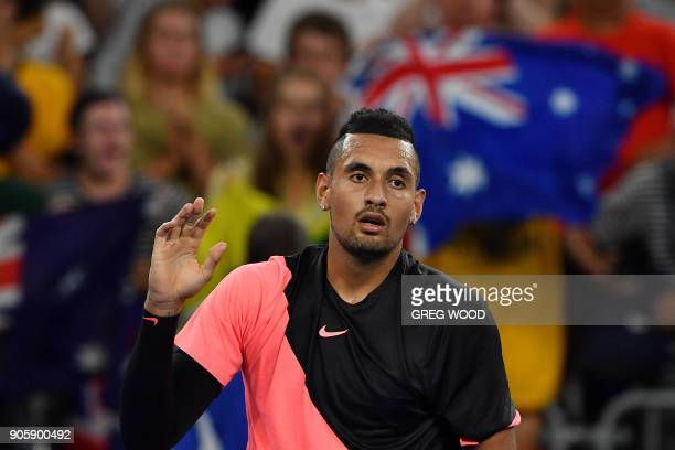 Australia's Nick Kyrgios reacts after beating Serbia's Viktor Troicki in their men's singles second round match on day three of the Australian Open...