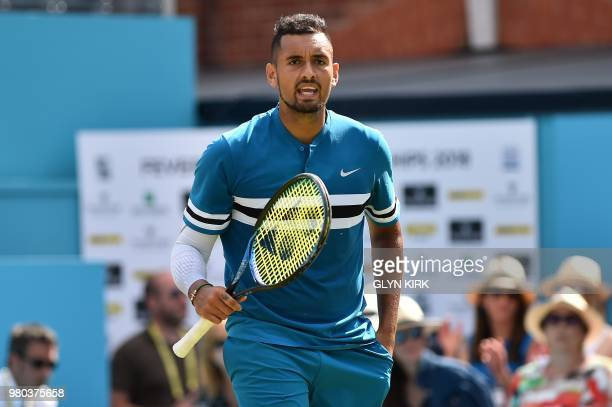 Australia's Nick Kyrgios reacts after winning against Britain's Kyle Edmund during their men's singles secondround match at the ATP Queen's Club...
