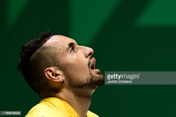 Australia's Nick Kyrgios reacts during his singles tennis match against Belgium's Steve Darcis at the Davis Cup Madrid Finals 2019 in Madrid on...