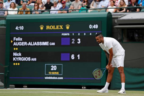 Australia's Nick Kyrgios reacts in pain as he plays against Canada's Felix Auger-Aliassime during their men's singles third round match on the sixth...