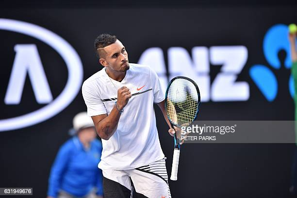 Australia's Nick Kyrgios reacts to a point against Italy's Andreas Seppi during their men's singles match on day three of the Australian Open tennis...
