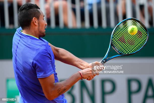 Australia's Nick Kyrgios returns the ball to Germany's Philipp Kohlschreiber during their tennis match at the Roland Garros 2017 French Open on May...