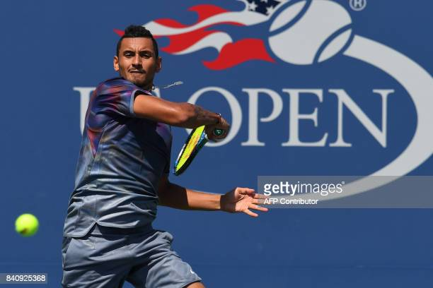 Australia's Nick Kyrgios returns the to Australia's John Millman during their Qualifying Men's Singles match at the 2017 US Open Tennis Tournament on...