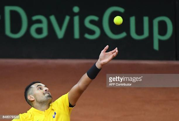 Australia's Nick Kyrgios serves against Belgium's David Goffin during their Davis Cup semifinal tennis match between Belgium and Australia in...
