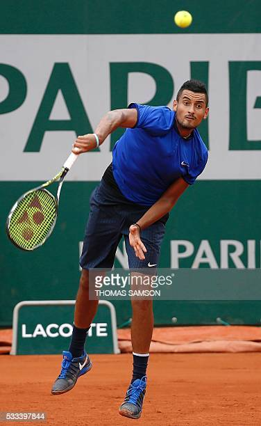 Australia's Nick Kyrgios serves the ball to Italy's Marco Cecchinato during their men's first round match at the Roland Garros 2016 French Tennis...