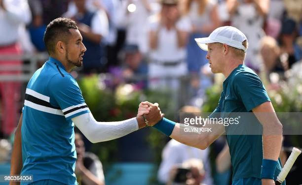 Australia's Nick Kyrgios shakes hands after winning against Britain's Kyle Edmund during their men's singles secondround match at the ATP Queen's...