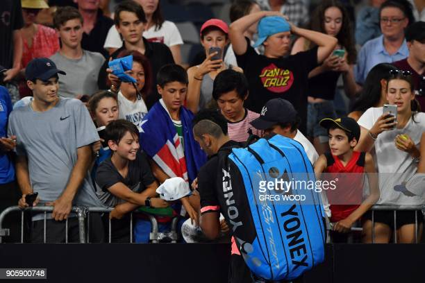 Australia's Nick Kyrgios signs autographs after beating Serbia's Viktor Troicki in their men's singles second round match on day three of the...