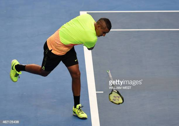 Australia's Nick Kyrgios smashes his racquet on court during his men's singles match against Italy's Andreas Seppi on day seven of the 2015...