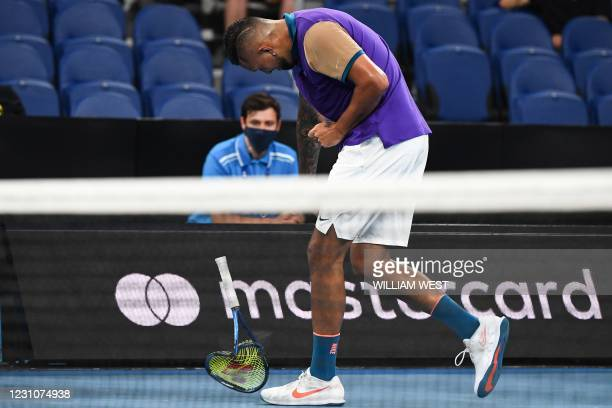Australia's Nick Kyrgios throws his racquet as he plays against France's Ugo Humbert during their men's singles match on day three of the Australian...