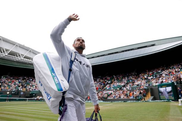 Australia's Nick Kyrgios waves to the crowd after withdrawing from his match against Canada's Felix Auger-Aliassime during their men's singles third...