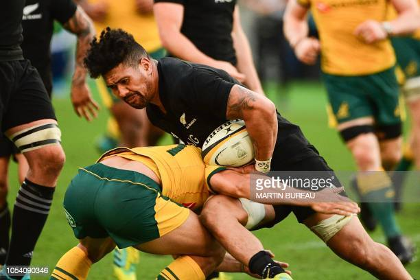Australia's Nick Phipps tackles New Zealand's flanker Ardie Savea during the Bledisloe Cup rugby union Test match between the New Zealand All Blacks...