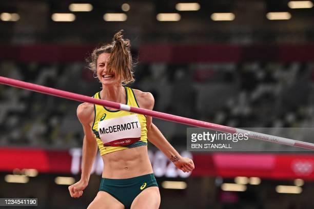 Australia's Nicola McDermott celebrates while competing in the women's high jump final during the Tokyo 2020 Olympic Games at the Olympic Stadium in...