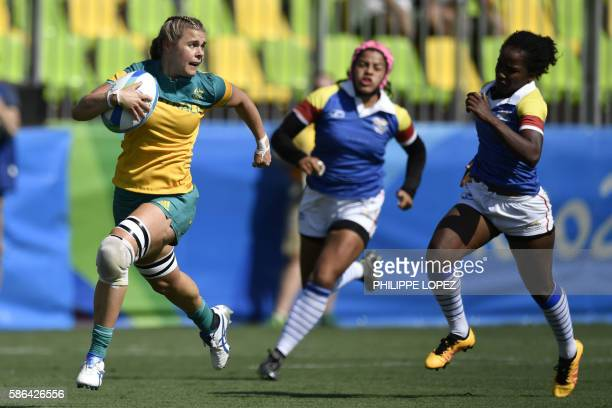 Australia's Nicole Beck scores a try in the womens rugby sevens match between Australia and Colombia during the Rio 2016 Olympic Games at Deodoro...