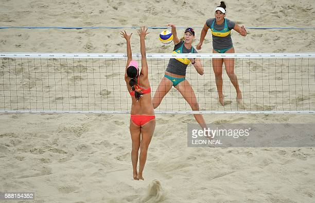Australia's Nicole Laird vies with China's Wang Fan during the women's beach volleyball qualifying match between China and Australia at the Beach...