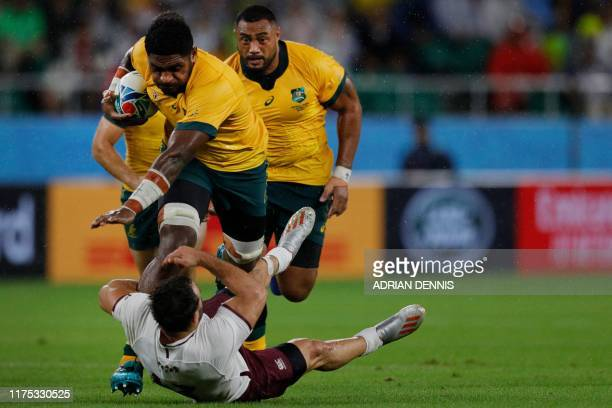 Australia's number 8 Isi Naisarani attempts to run past Georgia's centre Davit Kacharava during the Japan 2019 Rugby World Cup Pool D match between...