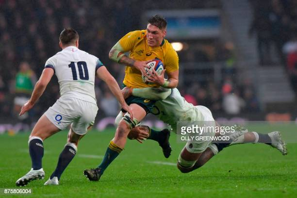 Australia's number 8 Sean McMahon is tackled by England's lock Courtney Lawes during the international rugby union test match between England and...
