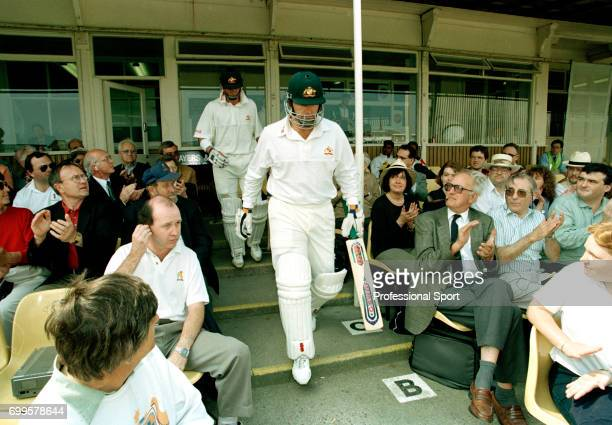 Australia's opening batsmen Mark Taylor and Matthew Elliott walk out to bat during the 1st Test match between England and Australia at Edgbaston...