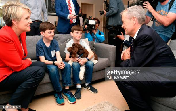Australia's opposition Labor leader Bill Shorten and deputy leader Tanya Plibersek chat with 10yearold twins Peter and Tom Davis during the first day...
