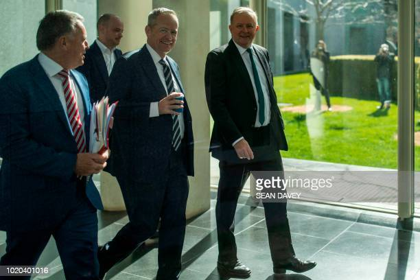 Australia's opposition leader Bill Shorten and Labor Party represetative Anthony Albanese walk in Parliament House in Canberra on August 21 2018...