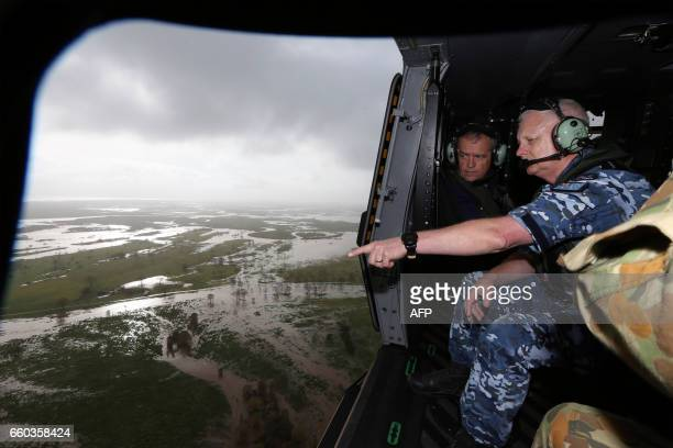 Australia's opposition leader Bill Shorten looks out over flood affected areas during a visit to see damage caused by Cyclone Debbie by helicopter in...