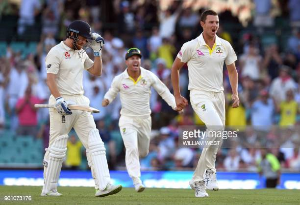 Australia's paceman Josh Hazlewood and teammate David Warner celebrate dismissing England batsman Jonny Bairstow on the first day of the fifth Ashes...