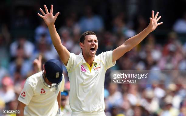 Australia's paceman Josh Hazlewood appeals successfully for an LBW decision against England batsman Alastair Cook on the first day of the fifth Ashes...