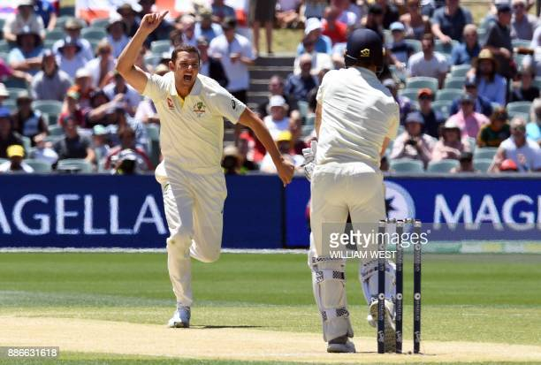 Australia's paceman Josh Hazlewood celebrates dismissing England batsman Chris Woakes on the final day of the second Ashes cricket Test match in...