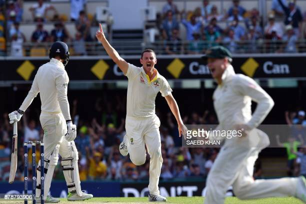 Australia's paceman Josh Hazlewood celebrates his wicket of England's James Vince on the third day of the first cricket Ashes Test between England...