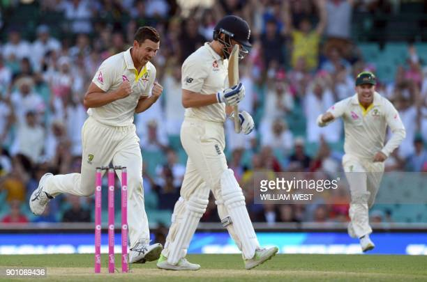 Australia's paceman Josh Hazlewood celebrates with teammate David Warner after dismissing England batsman Jonny Bairstow on the first day of the...