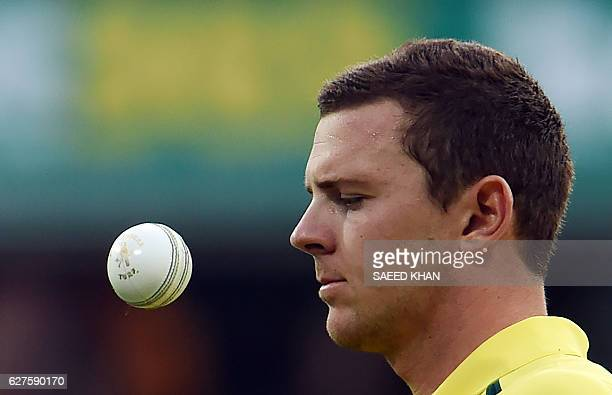 Australia's paceman Josh Hazlewood gets ready to bowl during the first game of the One Day International Cricket series between Australia and New...