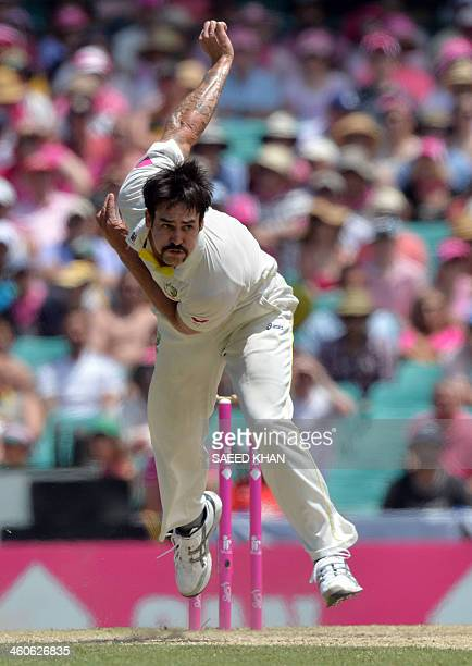Australia's paceman Mitchell Johnson bowls to England's batsman Ian Bell on the third day of the fifth Ashes cricket Test at the Sydney Cricket...