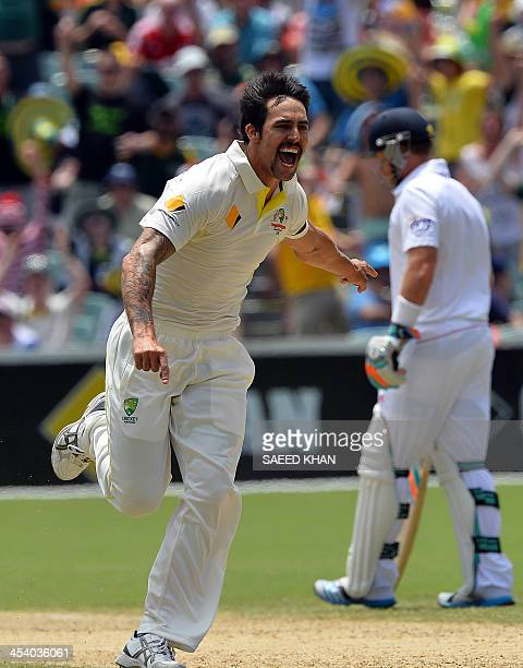 Australia's paceman Mitchell Johnson celebrates the wicket of England's Matt Prior during day three of the second Ashes Test cricket match in...