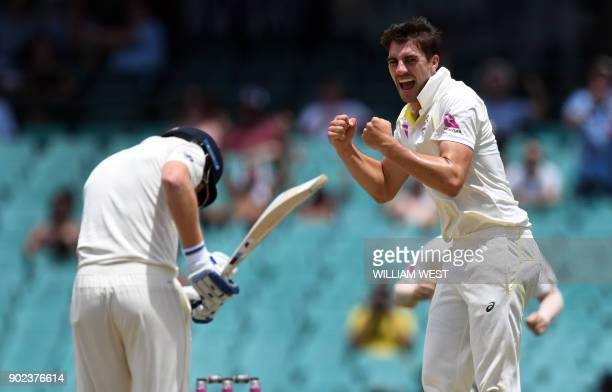 Australia's paceman Pat Cummins celebrates dismissing England's batsman Jonny Bairstow on the final day of the fifth Ashes cricket Test match at the...
