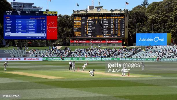 Australia's Pat Cummins bowls to the Indian batsman as India is dismissed for only 36 runs on the third day of the first cricket Test match between...