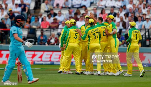 Australia's Pat Cummins celebrates with teammates after taking a catch for the dismissal of England's Jonny Bairstow during the 2019 Cricket World...