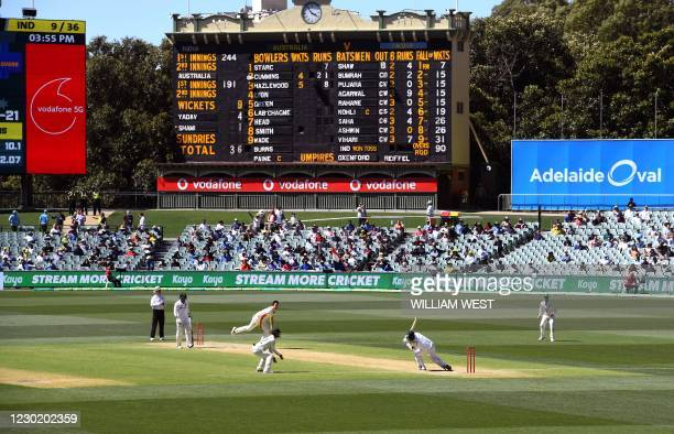 Australia's Pat Cummins fells India's Mohammed Shami with a bouncer as India is dismissed for only 36 runs on the third day of the first cricket Test...