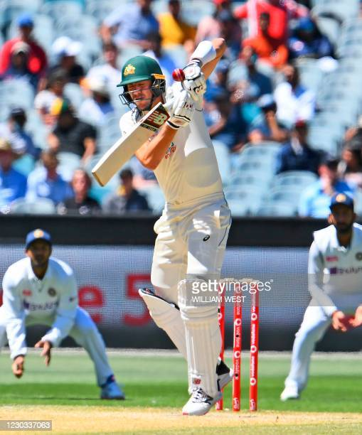 Australia's Pat Cummins fends the ball off with his glove and is caught on the fourth day of the second cricket Test match between Australia and...