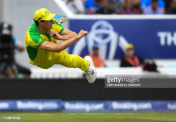 TOPSHOT Australia's Pat Cummins fields the ball during the 2019 Cricket World Cup group stage match between India and Australia at The Oval in London...