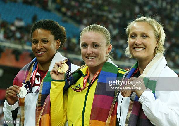 Australia's Pearson Sally and Canada's Whyle Angela win silver while Newzeland's Miller andrea win bronze in 100M women's event at XIX Commonwealth...